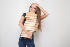 Girl with stacked books Royalty Free Stock Image