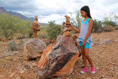Girl stacking rocks Royalty Free Stock Photography