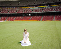 Girl in stadium Stock Photo