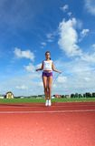 Girl in stadium Stock Photography
