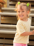 Girl on stadium tribunes. Young beautiful girl laughs against seats for spectators at stadium Royalty Free Stock Photography
