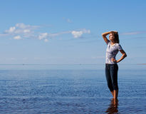 Girl is staing in the sea with closed eyes. Girl is staying in the sea Royalty Free Stock Photography