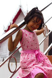 Girl with stainless steel railings. Stock Image