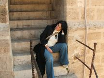 Girl on staircase Stock Photo