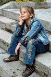 Girl on the staircase Stock Photos