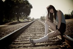 Girl on the Train Tracks stock photo