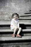 Girl on stairs Stock Photos