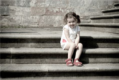 Girl on stairs Royalty Free Stock Photos
