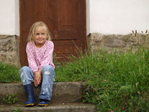 Girl on the Stairs. Girl sitting on the stairs royalty free stock photography