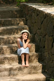 Girl on the stairs. Dreamy girl sitting on the stairs Stock Photos