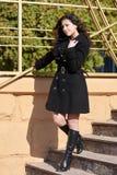 Girl on stairs at autumn season Stock Photos