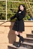 Girl on stairs at autumn season Stock Image