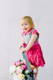 The girl on the stairs with flowers Royalty Free Stock Photos