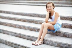Girl on the stairs Stock Images