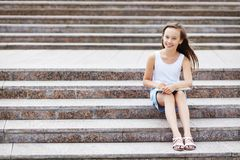Girl on the stairs Royalty Free Stock Images