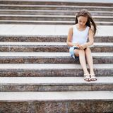 Girl on the stairs Stock Photos