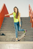 Girl on stairs with skateboard. Royalty Free Stock Image