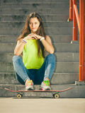 Girl on stairs with skateboard. Stock Image