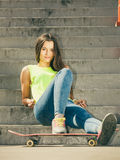 Girl on stairs with skateboard. Royalty Free Stock Photography