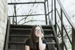 Girl on stairs royalty free stock photography