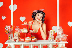 Girl in a stall with cakes and sweets. Royalty Free Stock Photo
