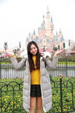 A girl stand in front of Disney Castle in Shanghai of China Stock Photos