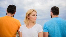 Girl stand in front two faceless men. Girl thinking whom she going ask dating. Best traits of great boyfriend. Everything you need to know about choosing right stock photo