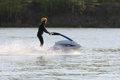 A girl stand on the jet ski. Royalty Free Stock Photos