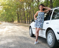 Girl stand near white car on road Royalty Free Stock Photography