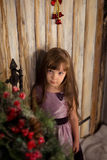 Girl stand on the porch waiting for Santa Claus Royalty Free Stock Photography