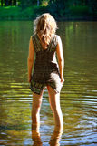 Girl stand in river Royalty Free Stock Photography