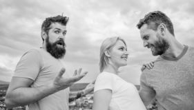 Girl stand between two men. Couple and rejected partner. Woman picked boyfriend. Love as competition concept. She made. Her choice. Start romantic relationships royalty free stock photos