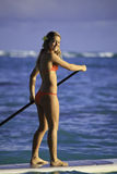 Girl on a stand up paddle board Stock Image