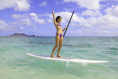 Girl on a stand up paddle board royalty free stock images