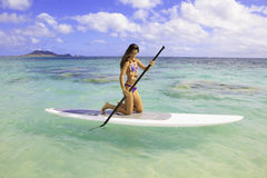 Girl on a stand up paddle board royalty free stock image