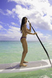 Girl on a stand up paddle board Stock Photo