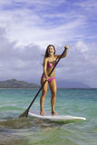 Girl on stand up paddle board Royalty Free Stock Photos