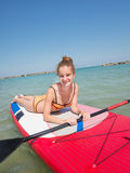 Girl on stand up paddle Royalty Free Stock Photo