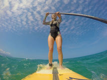 Girl stand up surfing Stock Photo