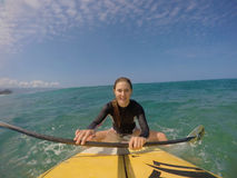 Girl stand up surfing Stock Images