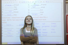 Girl Standing Against Projection Screen Royalty Free Stock Photography