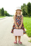 Girl standing alone on the roadside Stock Images