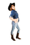 Girl standing as cowgirl. Stock Photo
