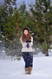 Girl standing on background winter trees Stock Images