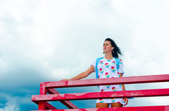 A girl standing on a balcony above the river Royalty Free Stock Images