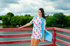 A girl standing on a balcony above the river Stock Photography