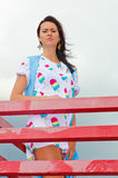 A girl standing on a balcony above the river Stock Images