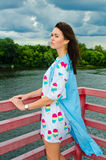 A girl standing on a balcony above the river Royalty Free Stock Image