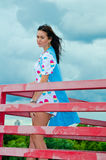 A girl standing on a balcony above the river Royalty Free Stock Photo
