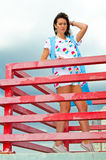 A girl standing on a balcony above the river Royalty Free Stock Photography